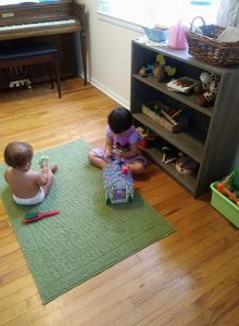 siblings sharing space during free play.
