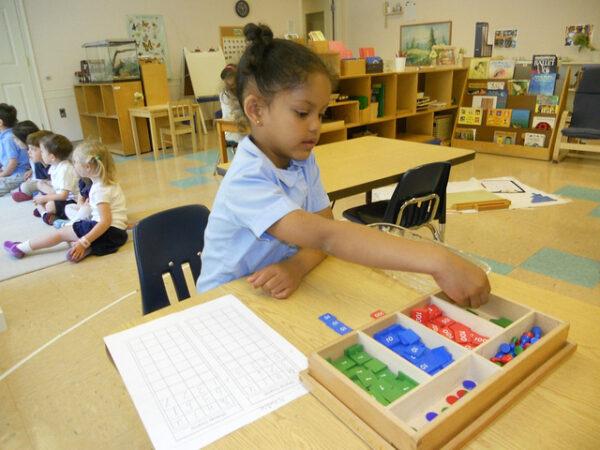 Girl in Montessori school showing how Montessori works.