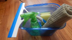 cleaning supplies in small bin. What are the benefits of practical life activities?