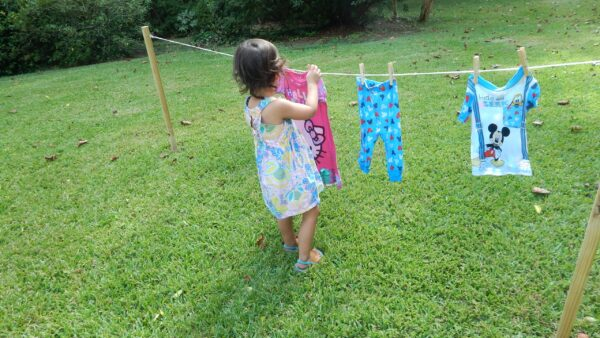 child hanging laundry a practical life activity.