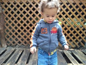 Toddler jumping from wooden pallet. Montessori: Expectation vs reality