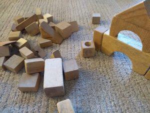 Wooden blocks strewn about. Montessori: expectation vs reality