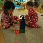 two children building with magna-tiles, great pre- Montessori math and common core skills.