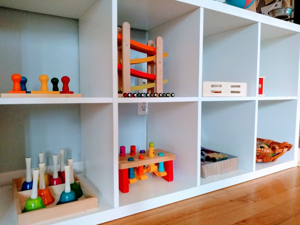 Montessori open toy shelves for toddlers for independent play.