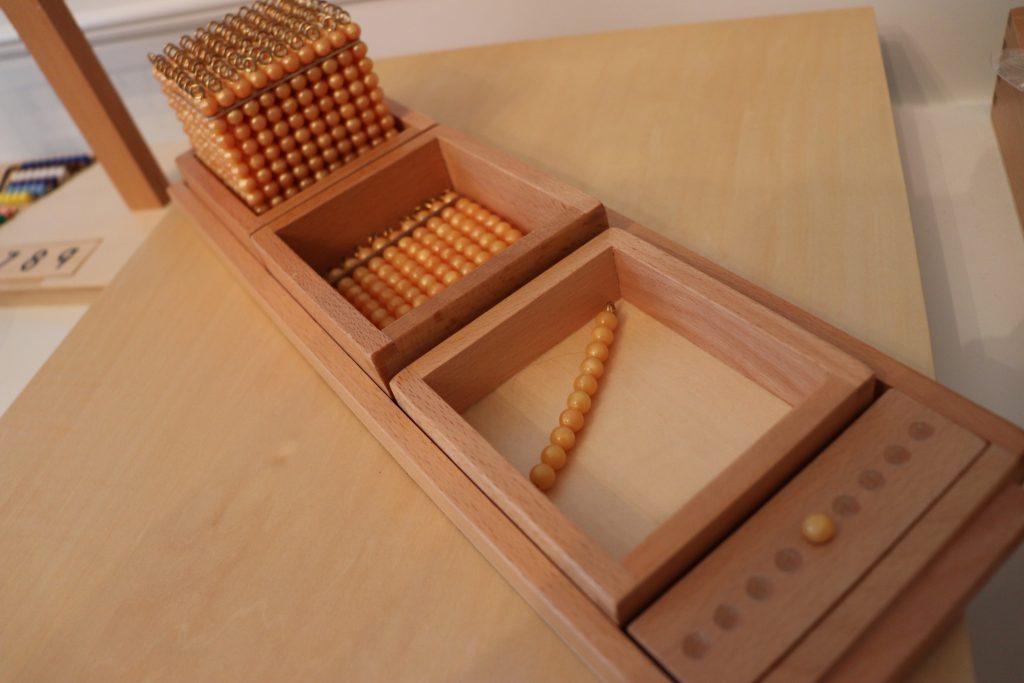 montessori golden bead material for math game.