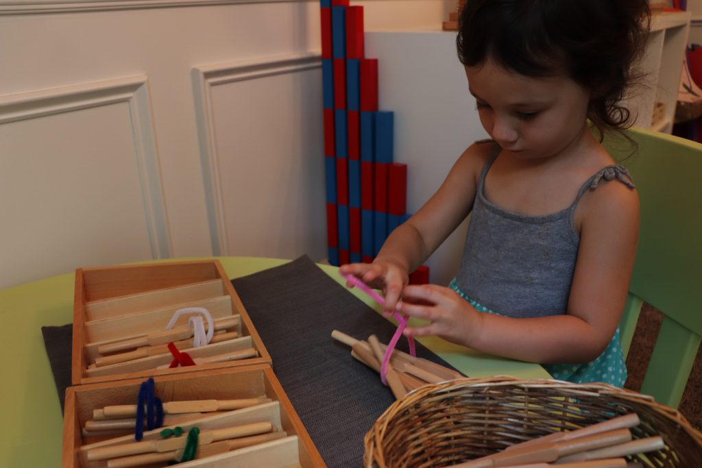 Child working with spindle boxes. These have a built in control of error