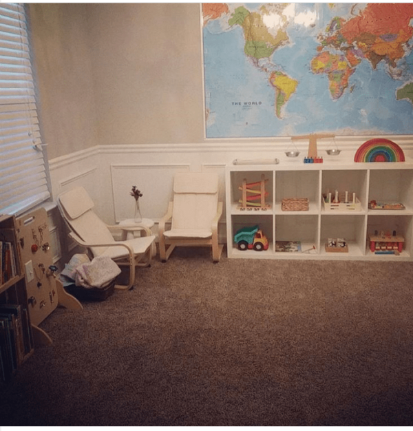 a decluttered play space for kids with open shelves and child-sized furniture is one way How To Get Started With Montessori in your own home.