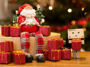 small santa with tiny red presents. Montessori christmas gift guide.