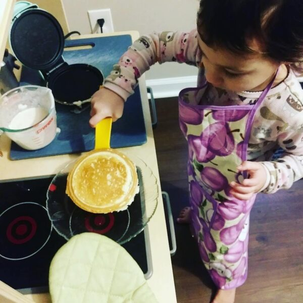 child cooking in ikea montessori play kitchen.