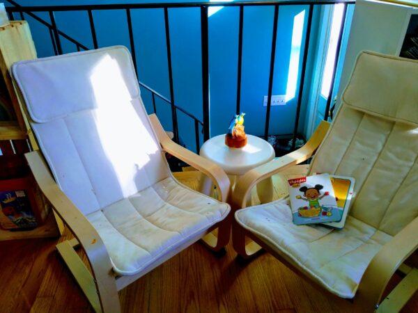 Child's reading nook using child-sized Montessori furniture.