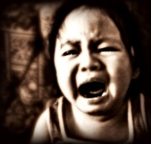 black and white image of toddler crying, tips for tantrums and meltdowns.