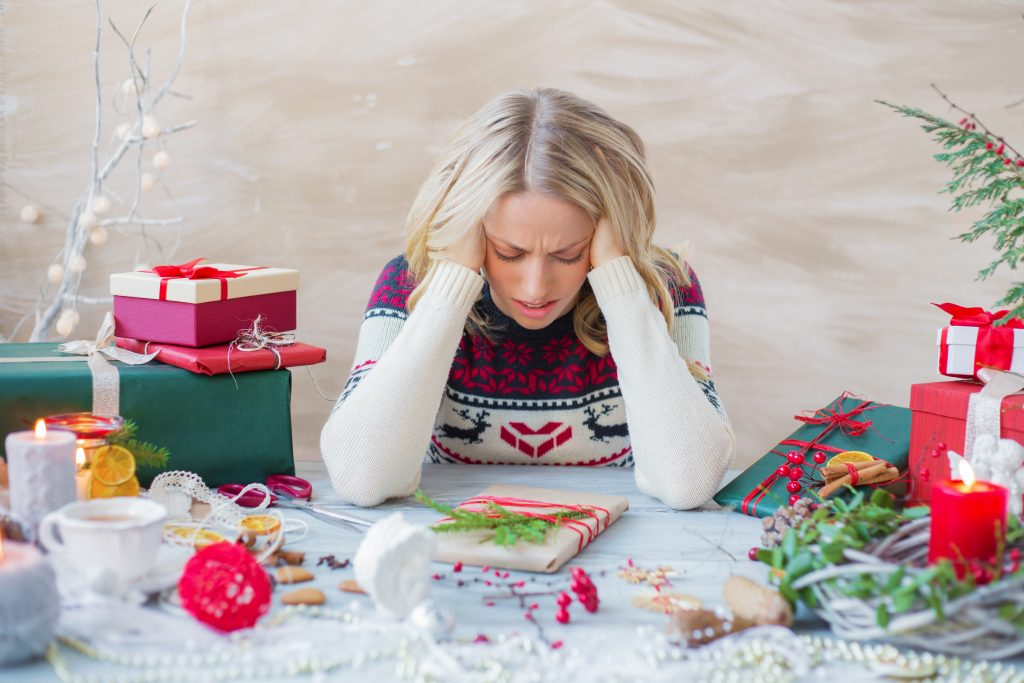 woman surrounded by gifts, stressed about how to accept gifts you don't want.