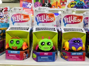 Loud, plastic toys on shelf.