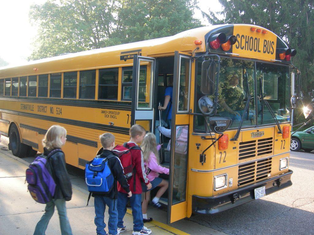 children getting on school bus. Do i need to send my child to preschool?