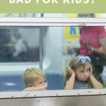 Kids on train waiting, is boredom bad for kids pinterest image.