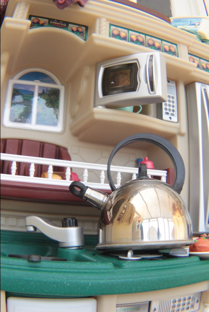 Play kitchen with tea kettle.