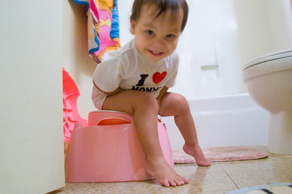 child on a potty chair. When can kids wipe their own butts?