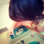 child learning Montessori land and water formations at Montessori homeschool.