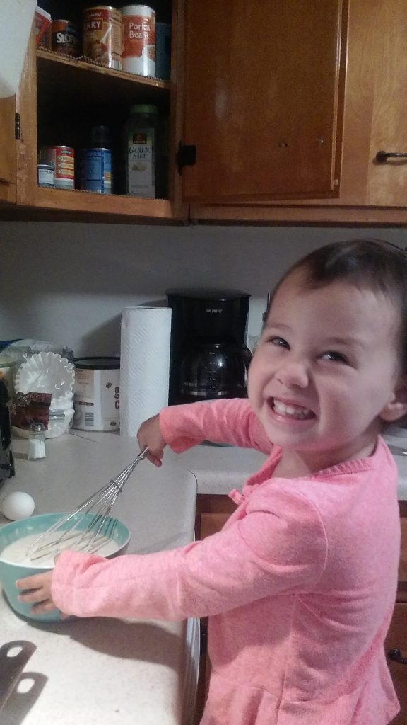 child helping in kitchen for quality time to prevent whining for attention