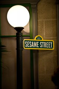 Sesame Street street sign and lamppost. Sesame Street is one of the quality tv programs for young children good for limited screentime.