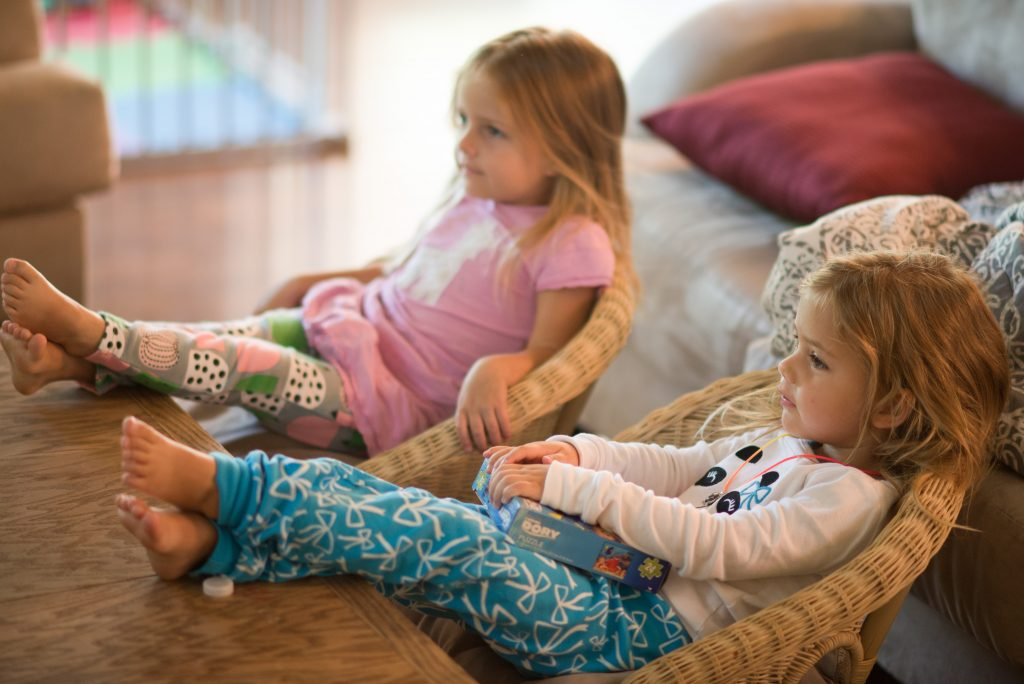 two girls watching quality tv programs for young children.