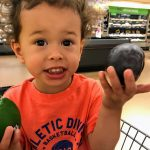 """How Picky Eaters Can Eat Healthy"" image of Toddler helping parent shop for fruit."