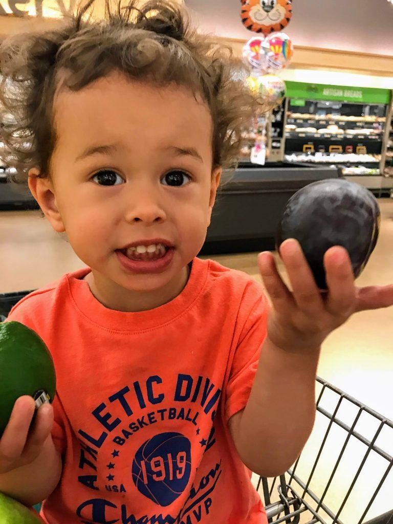 Toddler helping parent shop