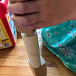 child stacking wooden blocks.