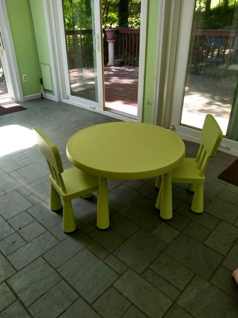 Kids sized ikea kids table in empty Montessori playroom.