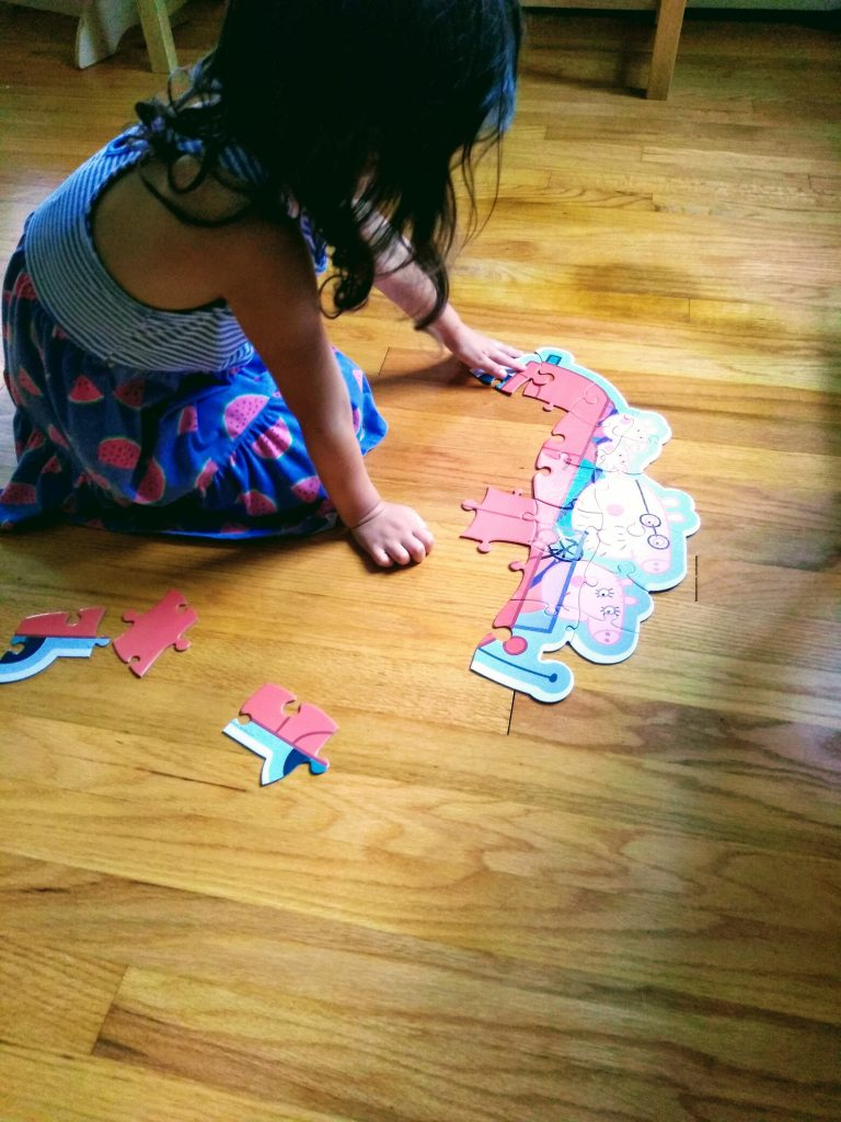 4 year old putting puzzle together. Puzzles are good for you.