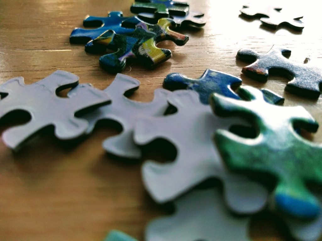 """Why puzzles are good for you"" image of puzzle pieces on table."