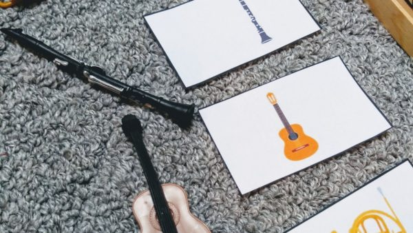 3 part cards and small musical instruments for musical instrument games for toddlers.
