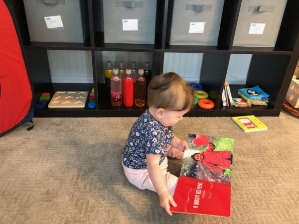 baby reading in yes space