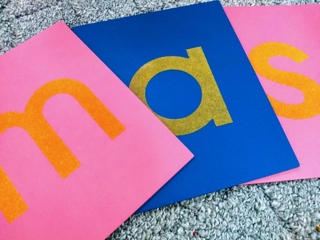 how do Sandpaper Letters work? close up photo of sandpaper letters.