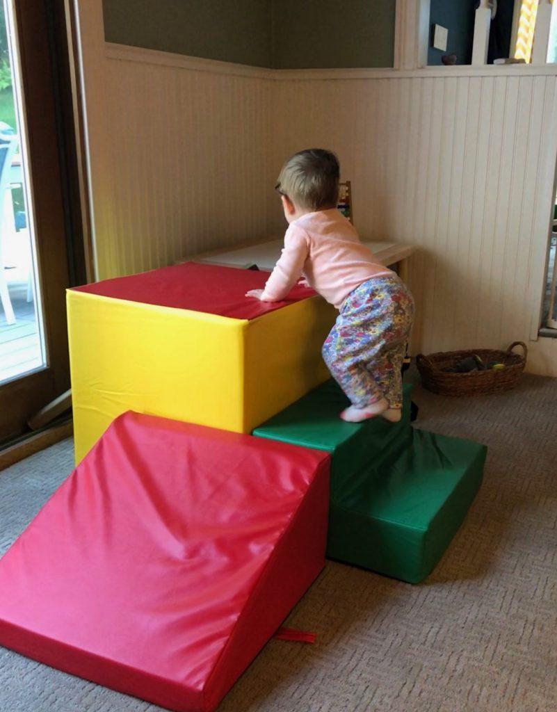 gross motor development baby climbing