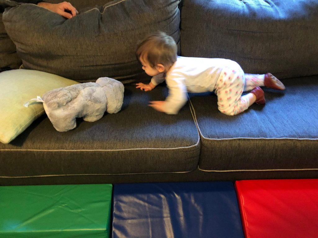 baby crawling on couch