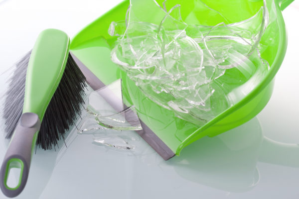 dustpan with broken glass, cleaning up their mess is an example of natural consequences.