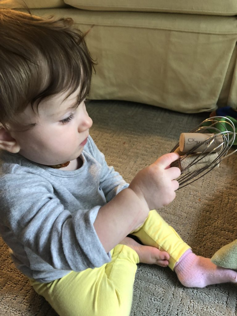 fine motor skill activity with whisk
