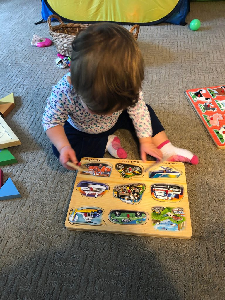 Baby doing puzzle, good for fine motor skills in babies.