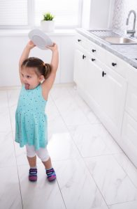 girl about to throw plate.