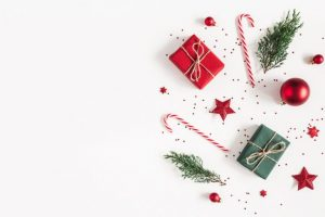 candy canes, red stars,red ornaments and small boxes of Montessori Christmas gifts.