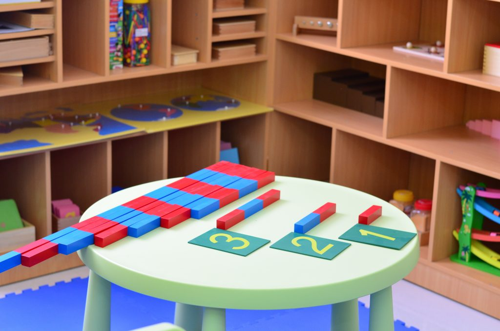 Number rods and Sandpaper Letters. Sensory learning is one of the many reasons a Montessori education works.