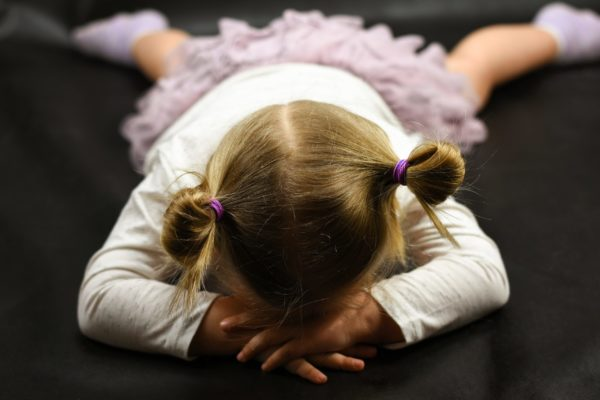 Positive Discipline image of girl crying on floor.