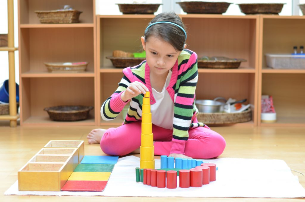 child working in the prepared environment of a Montessori classroom.