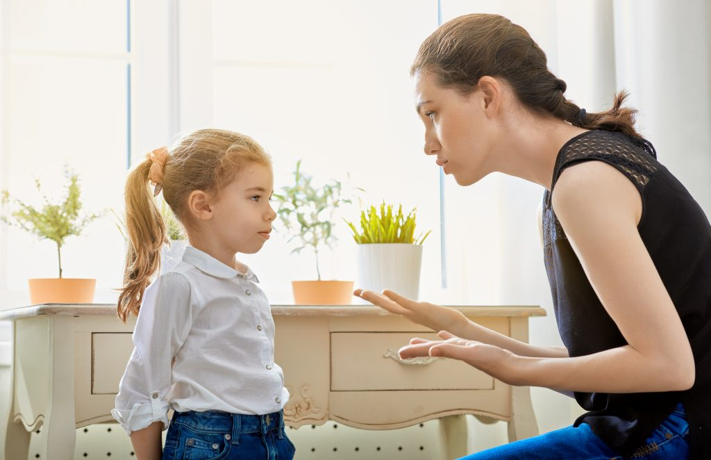 mom talking to child using time-in positive discipline technique.