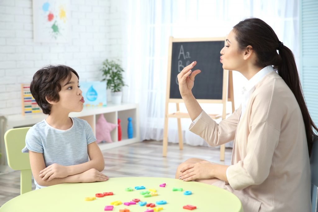 child working with occupational therapist