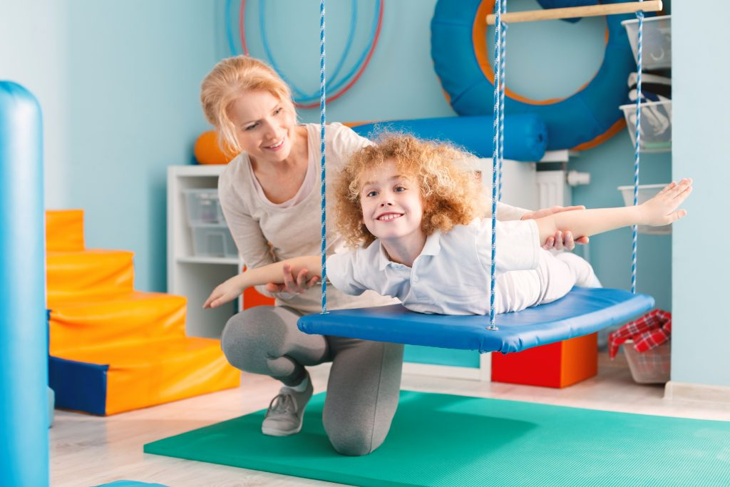 child in occupational therapy setting