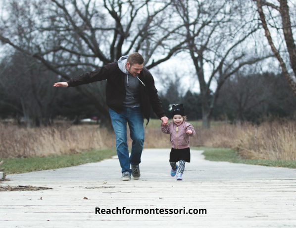 father running and laughing with son, and authoritative parenting style