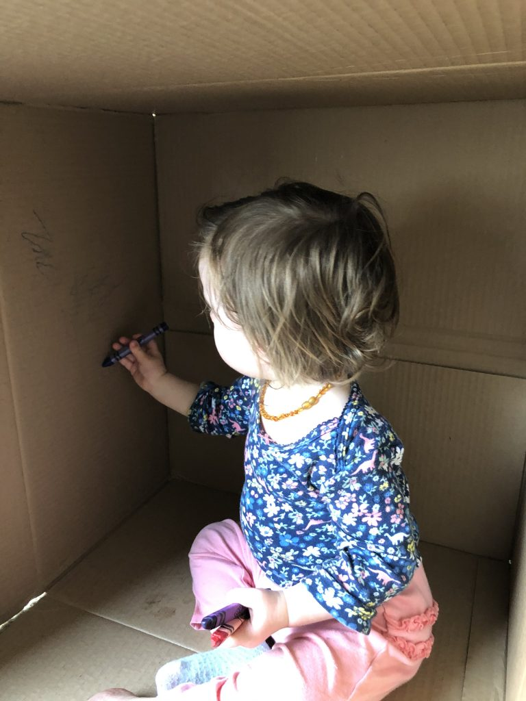 Toddler coloring inside box