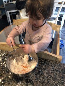 Toddler mixing slime